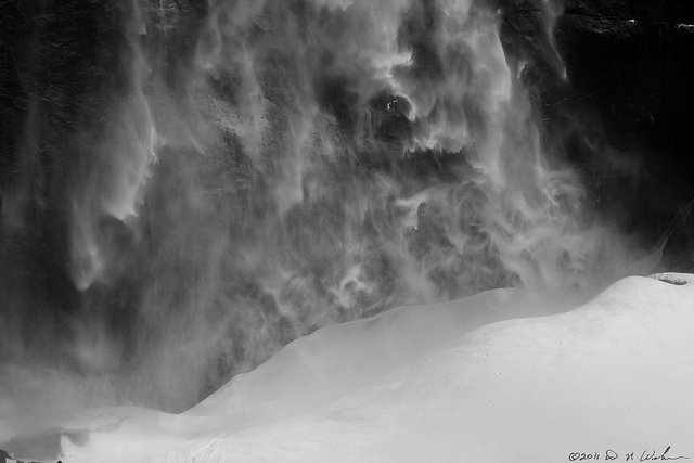 Water falling as frozen mist and forming a giant snow cone at the bottom