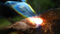 magnifying glass burning leaf