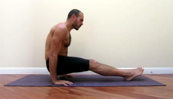 antranik demonstrating a foot supported l sit