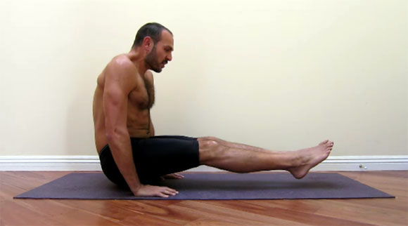 antranik demonstrating a full straight floor l sit