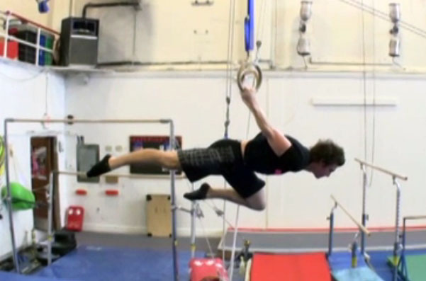 Carl Paoli demonstrating the one-knee-bent back lever, aka as the one leg back lever.