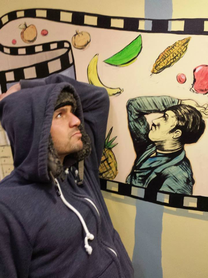 I'm at Trader Joes mocking the drawings on the walls...wearing my fluffy hat and hoodie over it for extra warmth and comfort.