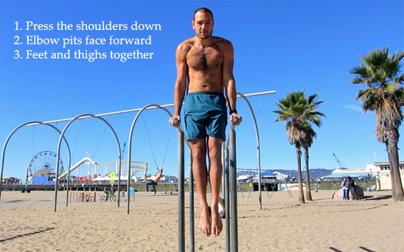 antranik holding support hold on parallel bars