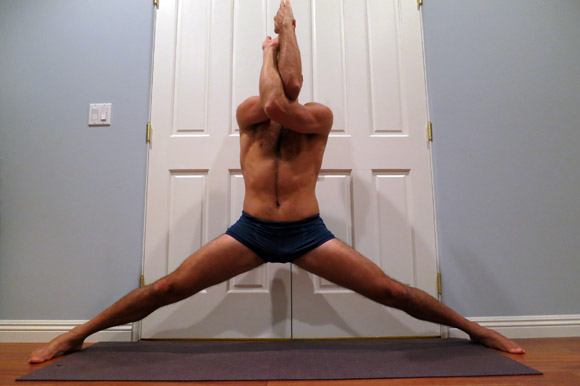 Holding middle split with eagle arms for bonus stretch.