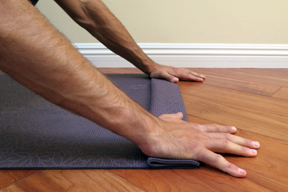 antranik-showing-a-wrist-modification-using-yoga-mat