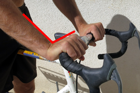 antranik-showing-bad-wrist-position-for-bicycling-handlebar