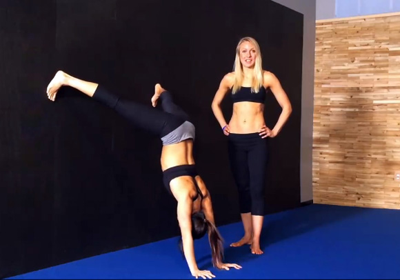 wall runs in straddle handstand